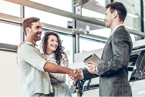 sales representative selling car to couple
