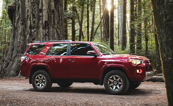 toyota 4runner - red exterior - forest backdrop