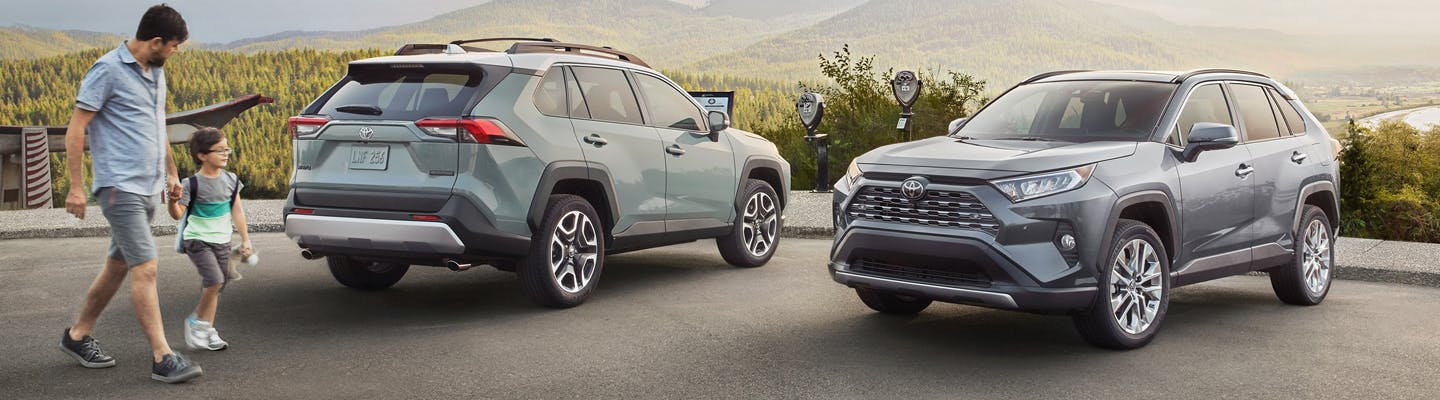 two toyota RAV4s - silver and gray exteriors