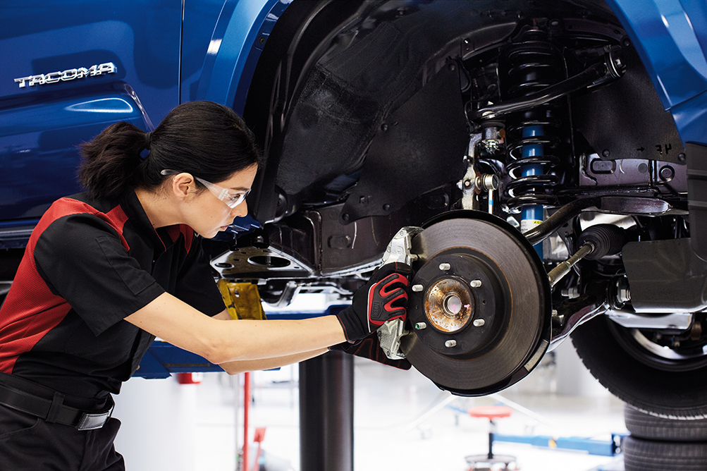South Hills Toyota is a Toyota Dealership in Canonsburg near Washington PA | Toyota mechanic fixing brakes on a Toyota vehicle