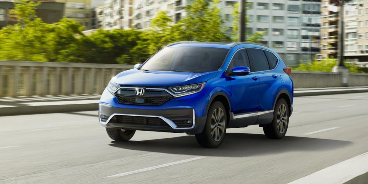 Washington Honda is a Honda Dealership in Washington near Bethel Park PA | Bright Blue 2020 Honda CR-V Driving Through City