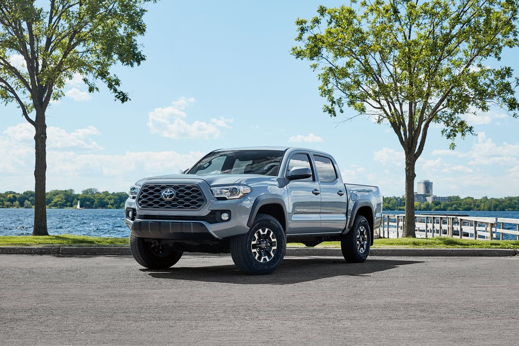 South Hills Toyota is a Toyota Dealership in Canonsburg near Meadowlands PA | Silver 2020 Toyota Tacoma parked by lake