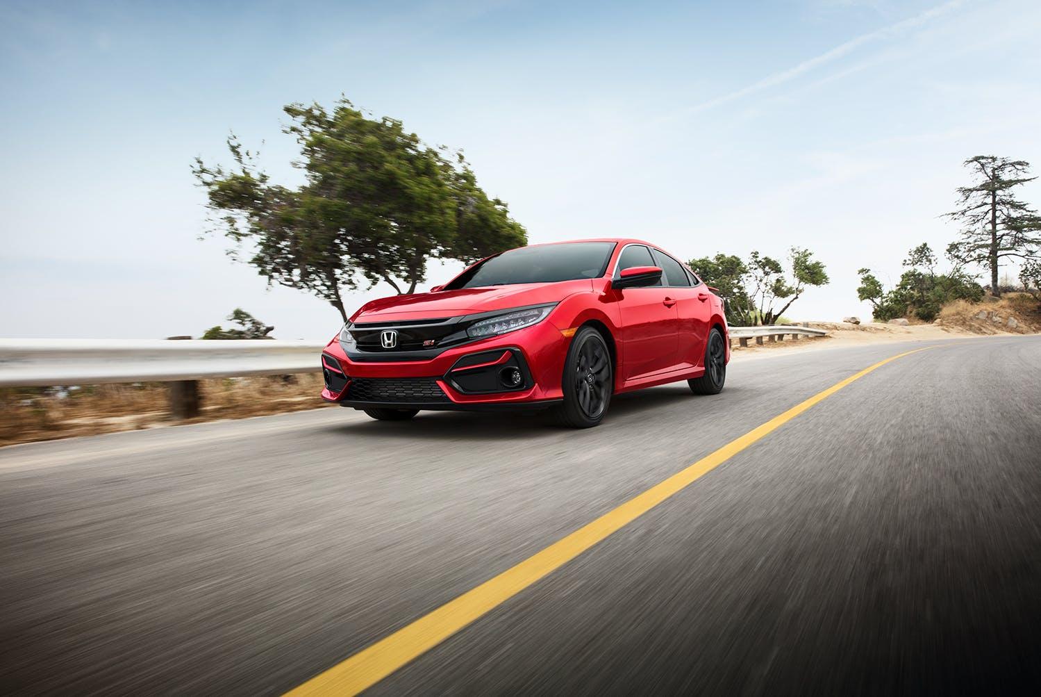 Washington Honda is a Honda Dealership near Arden, PA | Red 2020 Honda Civic sedan driving down road