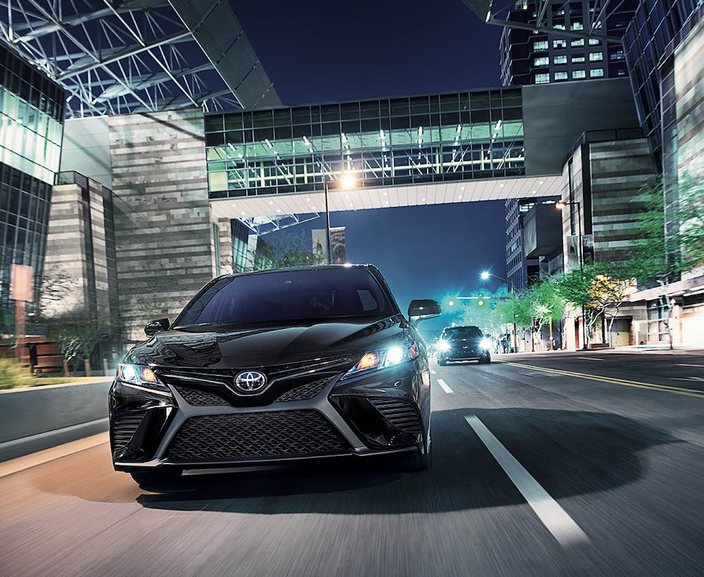 South Hills Toyota is a Toyota Dealership in Canonsburg near Hendersonville PA | 2020 Toyota Camry driving through city at night