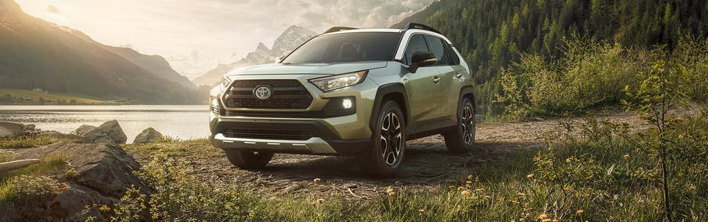 South Hills Toyota is a Toyota Dealership in Canonsburg near Hendersonville PA | 2020 Toyota RAV4 parked by lake