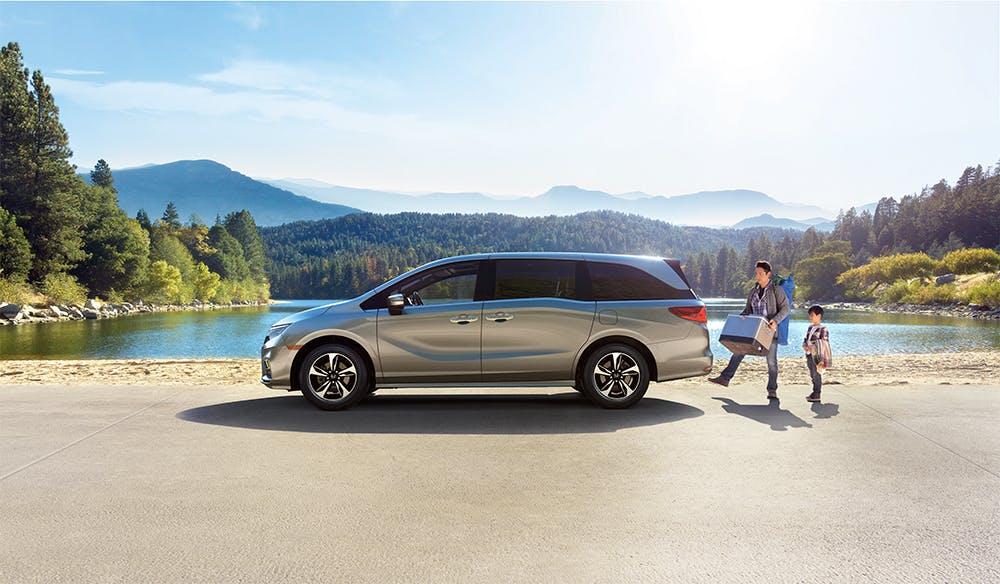 Washington Honda is a Honda Dealership near Wolfdale, PA | 2020 Honda Odyssey parked by a lake