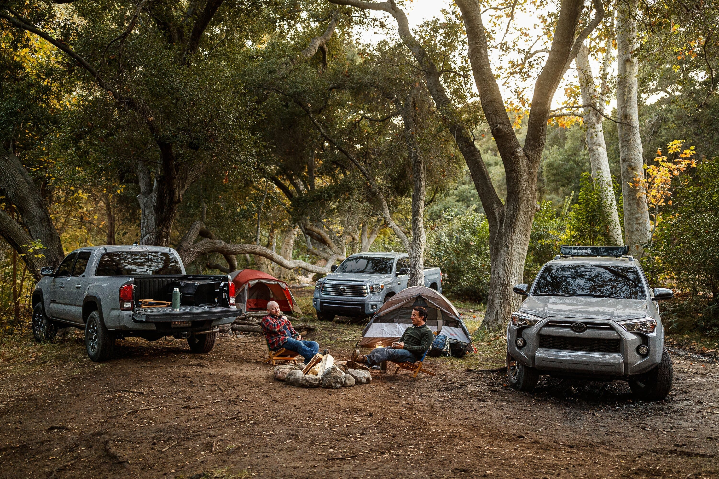 toyota trucks in forest with campers