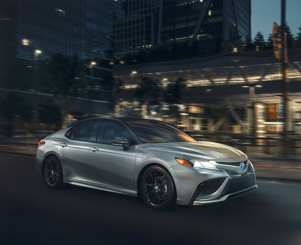South Hills Toyota is a Toyota Dealership in Canonsburg near McGovern PA | 2021 Toyota Camry Hybrid driving at night