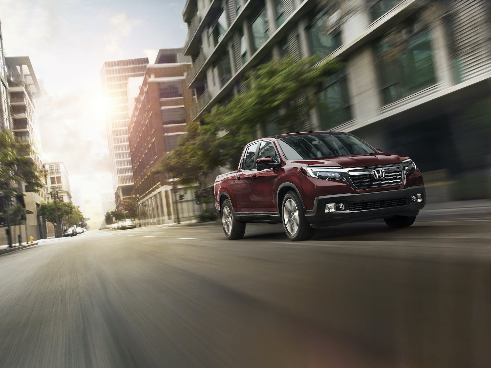 Washington Honda is a Honda Dealership near McGovern, PA | 2020 Honda Ridgeline driving through city
