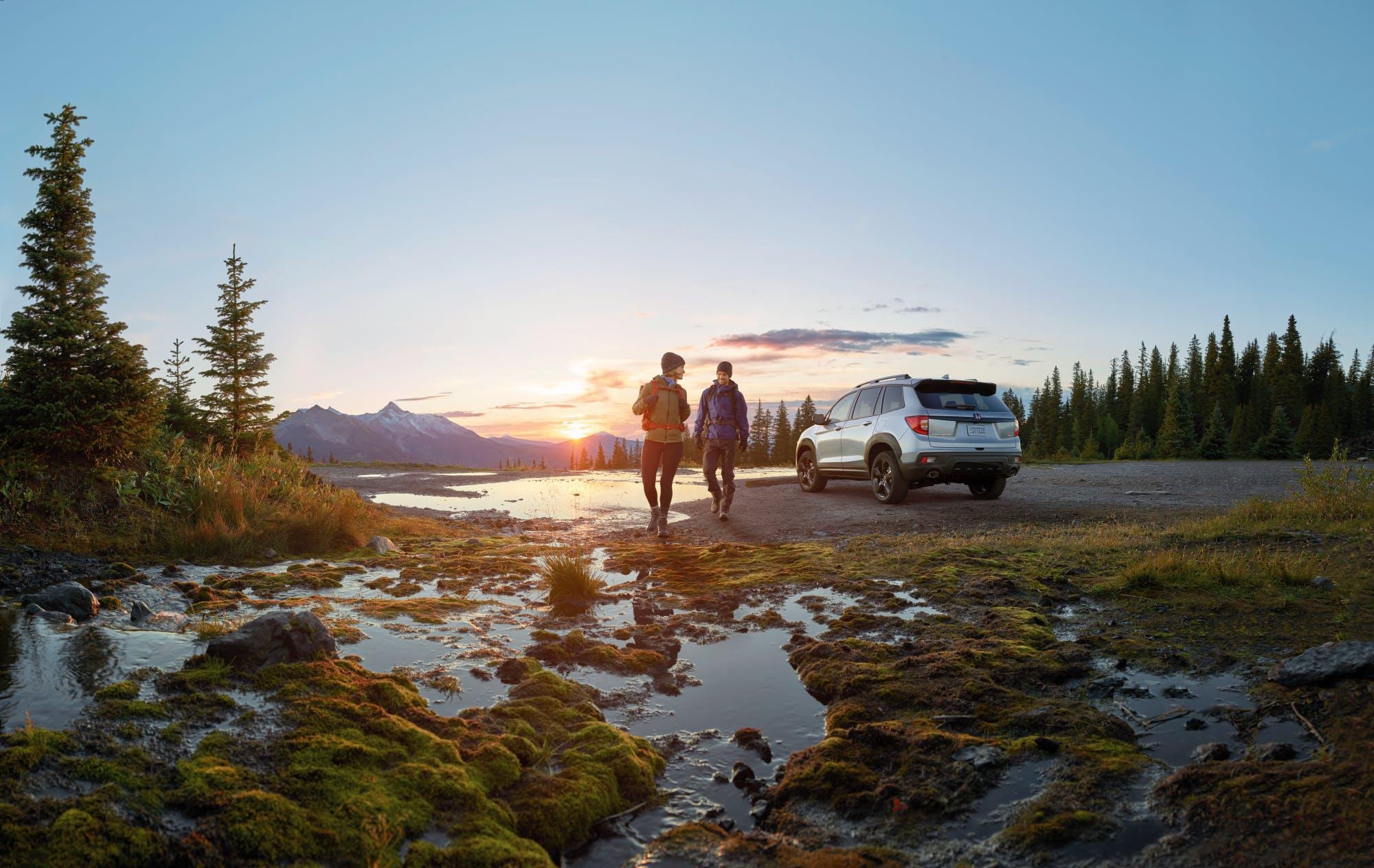 Washington Honda is a Honda Dealership near California, PA | hikers walking near 2020 Honda passport at sunset