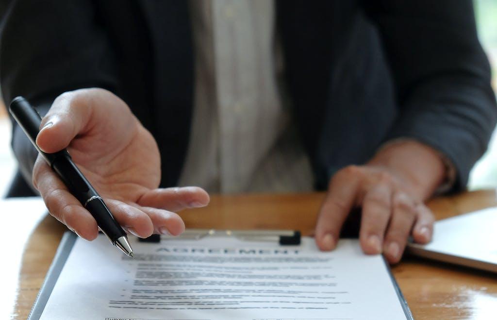 Washington Honda is a Honda Dealership near California, PA | Closeup of Honda sales associate showing customer where to sign